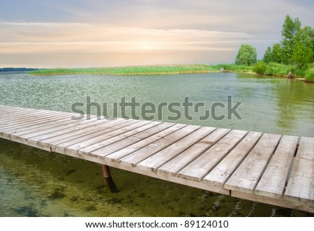 Wooden pier on beautiful lake.Nature composition. - stock photo