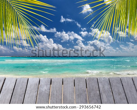 Wooden pier on caribbean beach view - stock photo