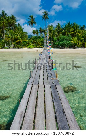 Wooden pier on the beach of Koh Kood island, vertical - stock photo
