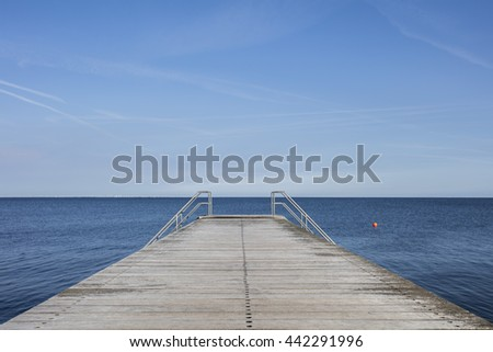 wooden pier on the blue sea