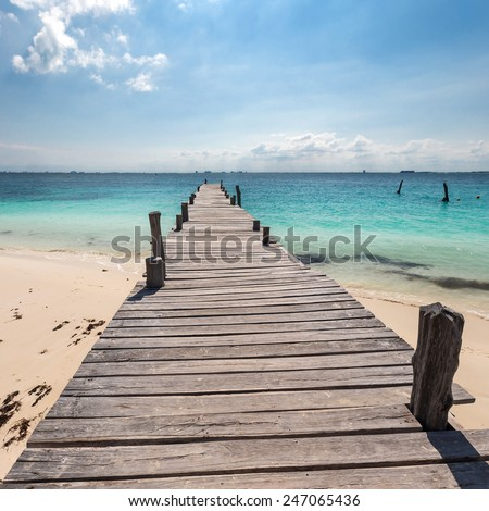 Wooden pier on tropical beach, Mexico, Cancun - stock photo