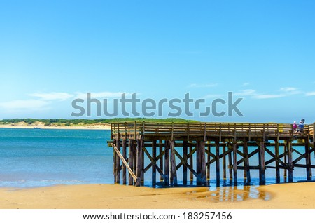 Wooden pier overlooking the Pacific Ocean in Lincoln City, Oregon - stock photo
