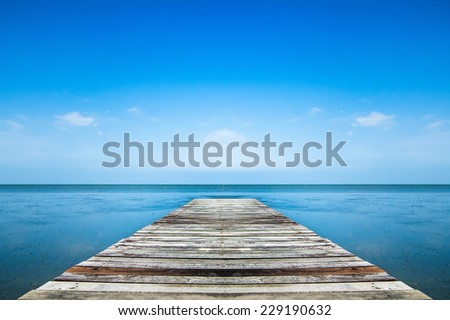 wooden pier to the sea with sky