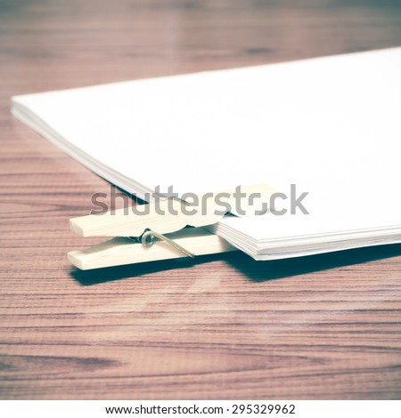 wooden pin paper on wood background vintage style - stock photo