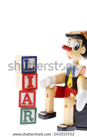 Wooden pinocchio and word liar - stock photo