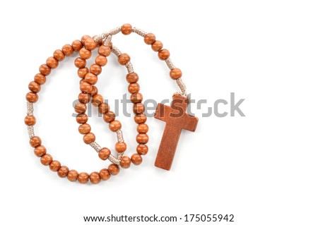 Wooden plain rosary on white background. Prayer beads use to count the repetitions of prayers - rosary of Virgin Mary. - stock photo