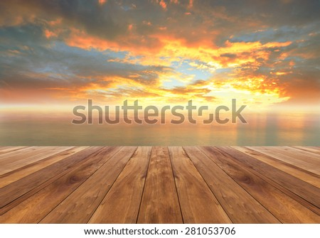 wooden plank and beautiful sunrise in the sea - stock photo