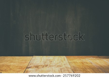 wooden planks and black board background. ready for mock up or product placement - stock photo