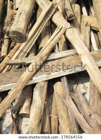 Wooden planks of a demolished house - stock photo