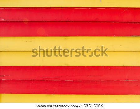 Wooden planks painted in spanish colours red yellow