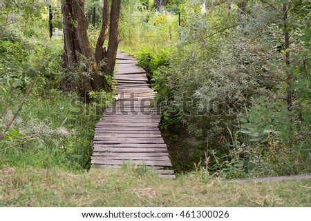 Wooden planks path over the ditch