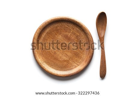 Wooden plate and spoon on white background - stock photo