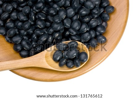 wooden plate with black soy beans on white background with clipping paths - stock photo