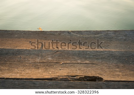 Wooden platform and and water in the park - stock photo