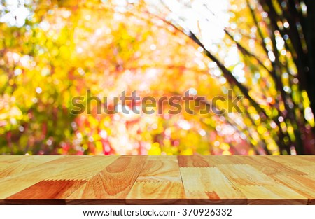 Wooden platform and Asian Bamboo forest with morning sunlight. - stock photo