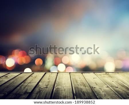 wooden platform and lights of night Hong Kong - stock photo