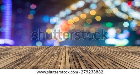 wooden platform and lights of night,shagnhai china. - stock photo