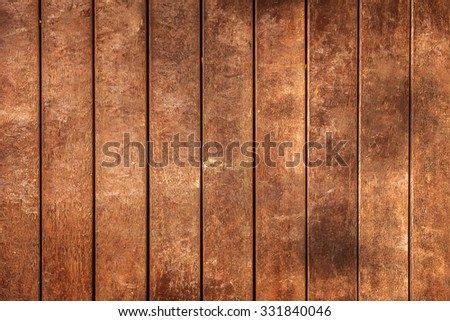 wooden platform beside beach with sunset - stock photo