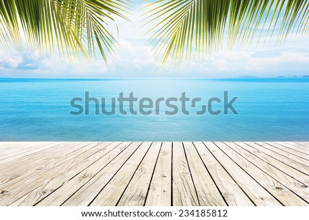 Wooden platform beside tropical sea - stock photo
