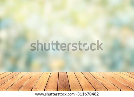 wooden platform with blur bokeh background - stock photo