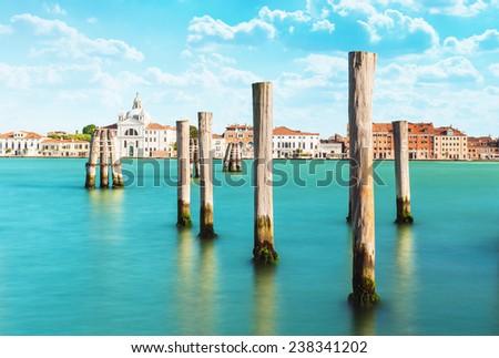 Wooden poles  in Venice, Italy. - stock photo