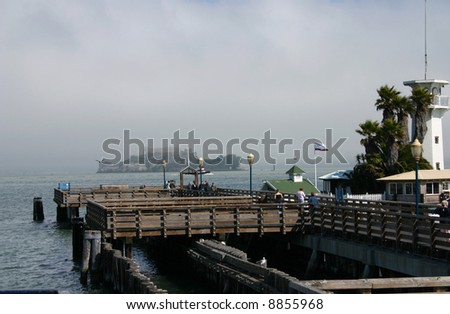 wooden port with view on Alcatraz island - stock photo