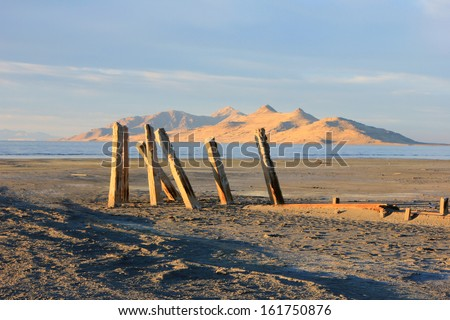 Wooden posts by the Great Salt Lake, Utah, USA. - stock photo