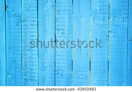 Wooden protection on all background, is painted light blue. - stock photo