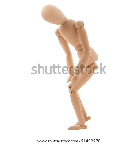 Wooden puppet have knee ache - stock photo