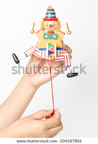 Wooden puppet in hand. - stock photo