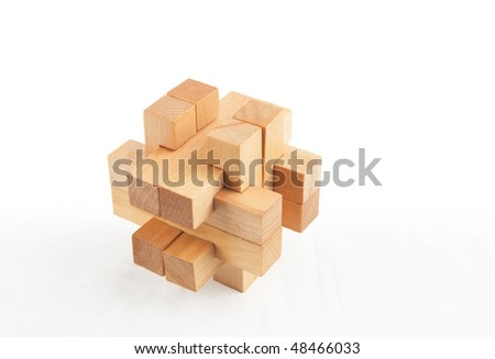 Wooden  puzzle. Isolated on white background - stock photo