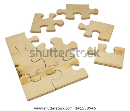 Wooden puzzle on white background. - stock photo