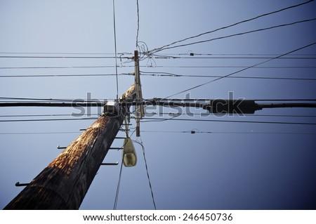 Wooden pylon with blue sky - stock photo