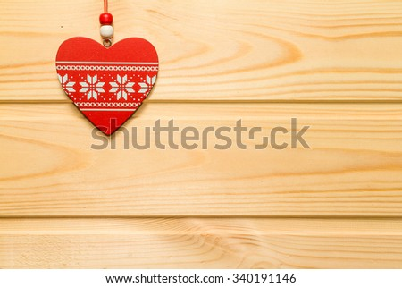 Wooden red heart suspended on a natural wood background.Valentine's day. - stock photo