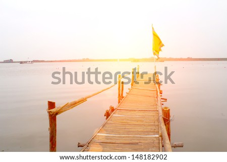 wooden road leading to the river - stock photo