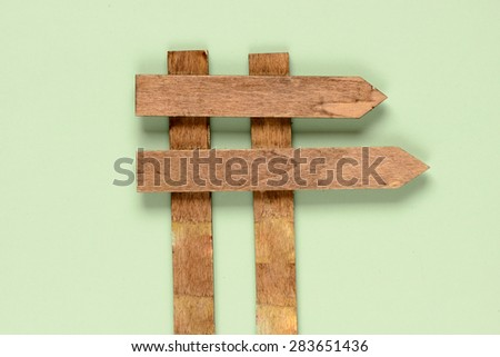 Wooden road sign isolated on green background