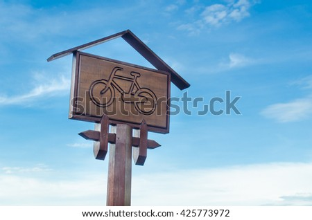 Wooden road signs with bike icon with blue sky background,Bike Route Sign - stock photo
