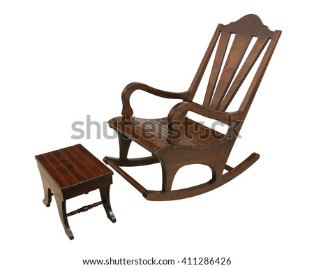 Wooden rocking chair and a foot stool. Isolated on white background.