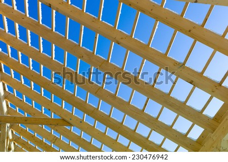 wooden roof construction, symbol photo for home, home construction, and home financing - stock photo