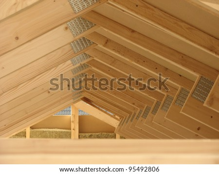 Wooden roof framework of the new house under construction - stock photo