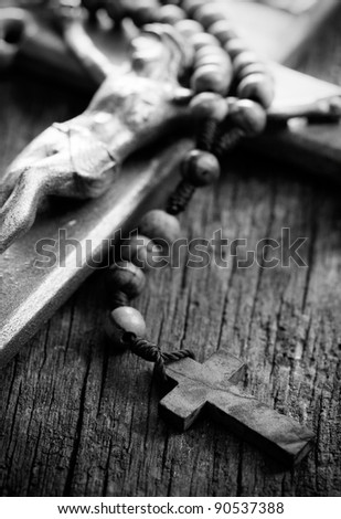 Wooden rosary beads and crucifix.b&w image. - stock photo