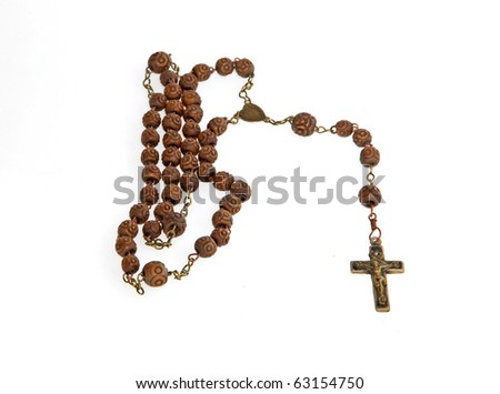 wooden rosary beads on white background - stock photo