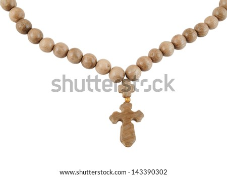 Wooden rosary with cross isolated on white background - stock photo