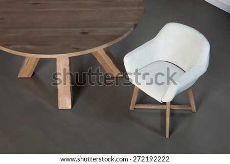 Wooden round table isolated with chair - stock photo