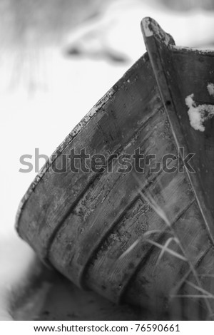 Wooden Rowboat wreck in the winter - stock photo