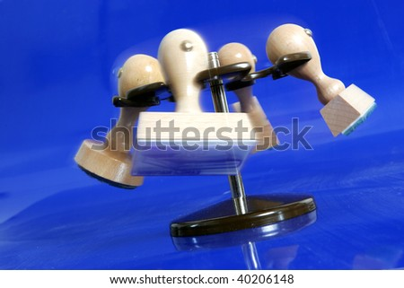 wooden rubber stamps, merry-go-round on blue background - stock photo