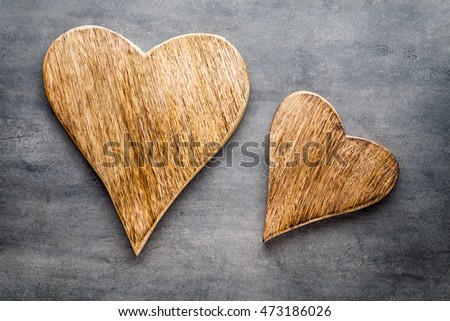 Wooden rustic heart on the grey background.