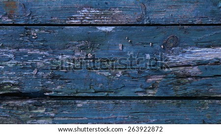 Wooden rustic surface of rough planks covered with peeling off blue paint  - stock photo