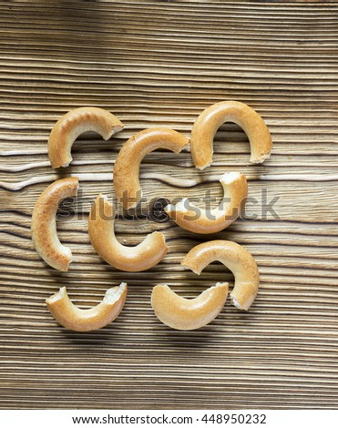 Wooden rustic table with a group of small dry russian cracked national bagels - stock photo