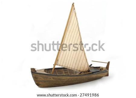 Wooden sailboat isolated on white background - stock photo